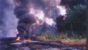 Oil spill fire on the river