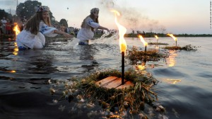 Midsummers eve in Belarus  - girls making offerings to the river